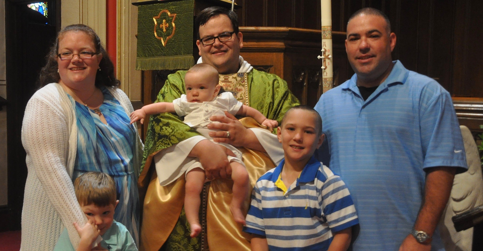 Family gathered for baby's baptism